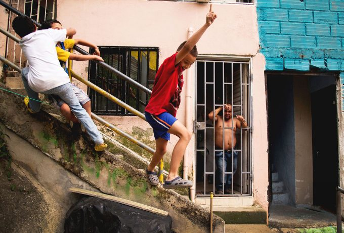 Children playing and jumping from a staircase.
